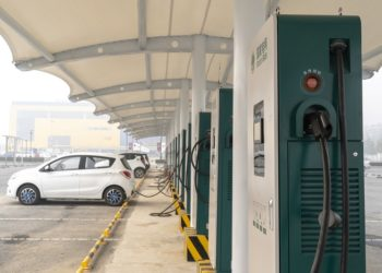 TIANJIN, CHINA - 2018/11/26: A charging station on a parking lot in a hazy day.  Facing the severe environmental damage  and energy problems, China made  great effort to encourage usage of electric cars and built a lot of charging stations in public parking lot or highway service area. (Photo by Zhang Peng/LightRocket via Getty Images)